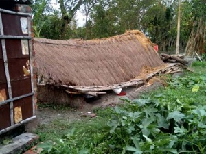 Example of a house with a thatch roof that has collapsed